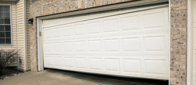 Potential Risks from Avoiding Emergency Garage Door Repair